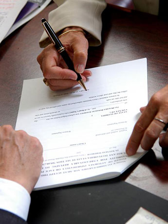 Men Signing a Contract